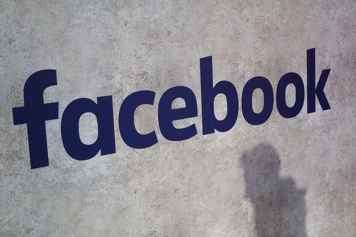 File - This Jan. 17, 2017, file photo shows a Facebook logo being displayed in a start-up companies gathering at Paris' Station F, in Paris. A former employee of a Trump-affiliated data-mining firm says it used algorithms that