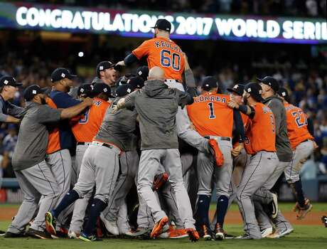 Houston Astros pitcher Dallas Keuchel (60) gets lifted up by teammates after Game 7 of the World Series at Dodger Stadium on Wednesday, Nov. 1, 2017, in Los Angeles. ( Karen Warren  / Houston Chronicle )