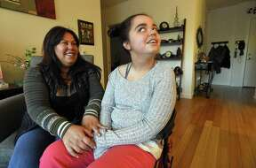 Renae McKay and her 15-year-old daughter, Dylan, are photographed at their home in Stamford, Conn., on Friday, March 16, 2018. Dylan has cerebral palsy and attends Stamford Schools. The number of snow days recorded this year has impacted parents financially. Families have had to change vacation plans, with the end of school now being pushed back over a week. Renae is a single parent whose daughter needs full time care and every time there's a snow day, she has to spend about $120 for a caretaker to come the whole day.