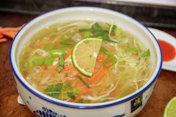 This March 12, 2018 photo shows a cabbage soup made with ginger and garlic broth in Bethesda, Md. This dish is from a recipe by Melissa d'Arabian. (Melissa d'Arabian via AP)