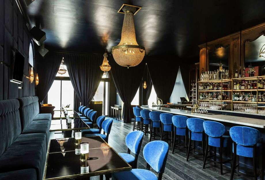 Above: Victor, a new French-themed cocktail bar and lounge in Montrose, sports a luxe interior. Left: Victor serves patés, meat and cheese boards. Photo: Julie Soefer