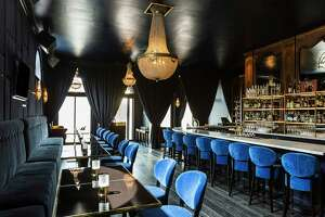 Above: Victor, a new French-themed cocktail bar and lounge in Montrose, sports a luxe interior. Left: Victor serves patés, meat and cheese boards.