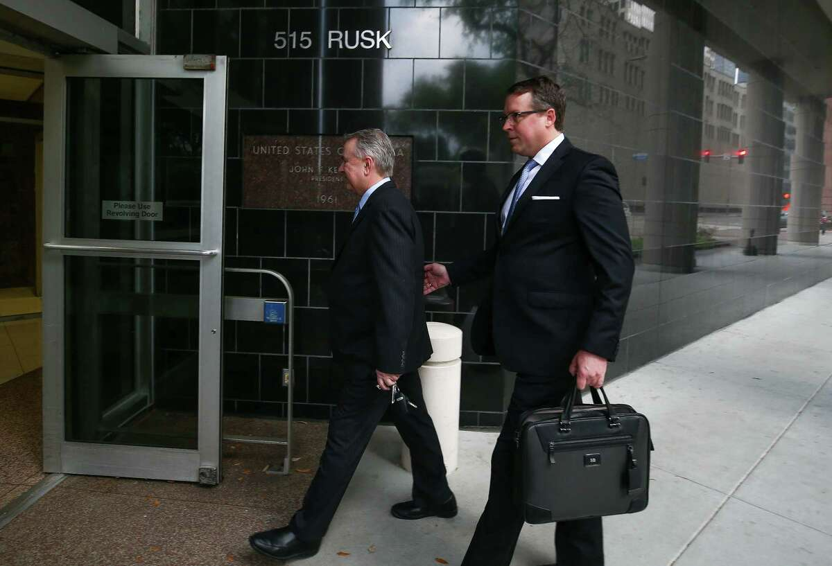 Former U.S. Congressman Steve Stockman, left, and his attorney Sean Buckley walk into the Federal Courthouse for the start of federal corruption trial against Stockman Monday, March 19, 2018, in Houston.