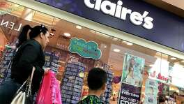 People walk by a Claire's store at the Northgate Mall on March 19, 2018 in San Rafael, California. Teen jewelry chain store Claire's announced that they have filed for Chapter 11 bankruptcy in an effort to eliminate $1.9 billion in debt and plans to shutter underperforming stores.