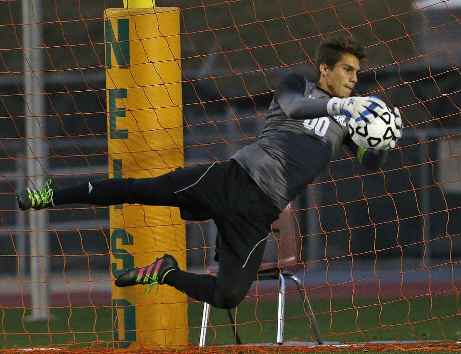 Reagans' Eugene Albo makes a save from District 26-6A high school boys soccer showdown between No. 1 Reagan and No. 2 Lee on  Tuesday, February 6, 2018 at Comalander Stadium Photo: Ronald Cortes, For The San Antonio Express News / 2017 Ronald Cortes