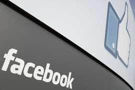 (FILES)A Facebook sign is seen at the main entrance of Facebook's new headquarters in Menlo Park in this February 1, 2012 file photo in California.  Facebook announced April 23, 2012 it would pay Microsoft $550 million USD for some of the patents the software giant recently acquired from AOL. Facebook will pick up around 650 of the 925 patents Microsoft bought earlier this month in an auction from AOL in a nearly $1.1 billion USD deal, Facebook and Microsoft said in a statement. AFP PHOTO / Kimihiro Hoshino / FILES (Photo credit should read KIMIHIRO HOSHINO/AFP/Getty Images)