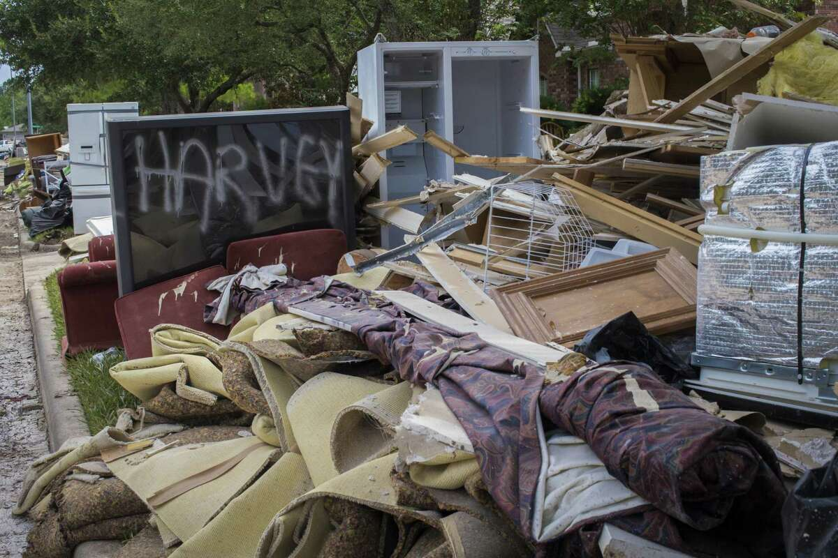 Debris and trash from the floods caused by flooding after the passing of Hurricane Harvey waits to be picked up at a home in Cinco Ranch in Katy last September.