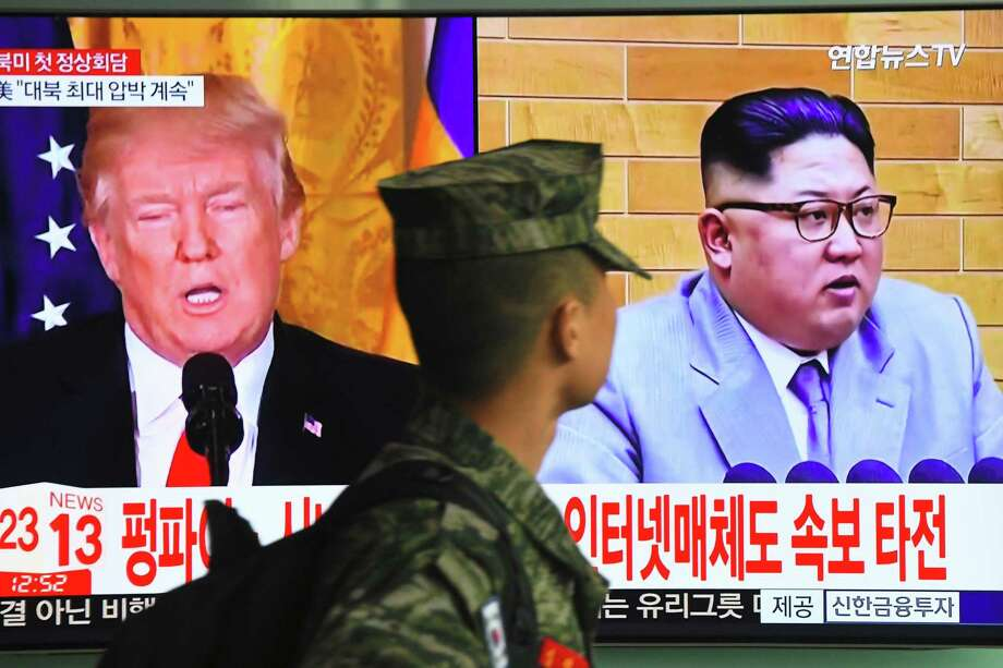 A South Korean soldier walks past a television screen showing pictures of President Donald Trump and North Korean leader Kim Jong Un at a railway station in Seoul on March 9, 2018. Trump agreed on March 8 to a historic first meeting with North Korean leader Kim Jong Un in a stunning development in America's high-stakes nuclear standoff with North Korea. Photo: JUNG YEON-JE, Contributor / AFP/Getty Images / AFP or licensors