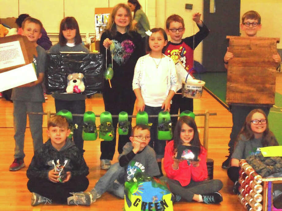 "Students from North Elementary School's ""Green Team"" stand with their projects made out of recycled materials."