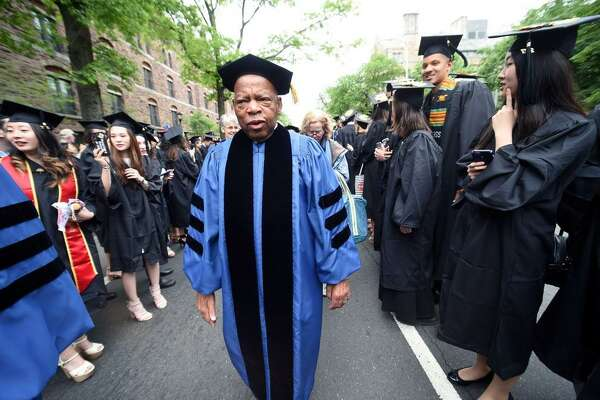 (Arnold Gold-New Haven Register)  U.S. Rep. John Lewis processes between rows of graduates on Elm Street at Yale University Commencement in New Haven on 5/22/2017.  Lewis received an honorary Doctor of Laws degree.
