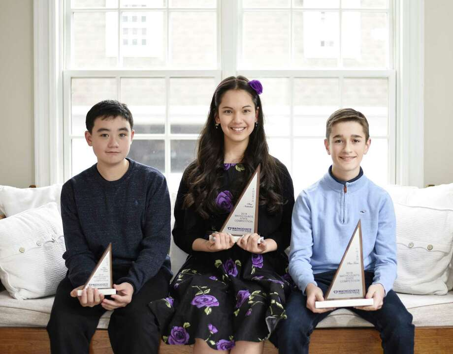 Greenwich Academy eighth-grader Natalie Shell poses beside Western Middle School seventh-grader Brandon Yu, left, and Brunswick School seventh-grader Glen Cahilly at her home in Old Greenwich, Conn. Wednesday, March 14, 2018. Shell placed fourth in the Connecticut MATHCOUNTS individual competition and will be heading to the national competition held in Washington, D.C. in early May. Yu placed first in the countdown round and Cahilly was part of the Brunswick team that placed third overall. Photo: Tyler Sizemore / Hearst Connecticut Media / Greenwich Time