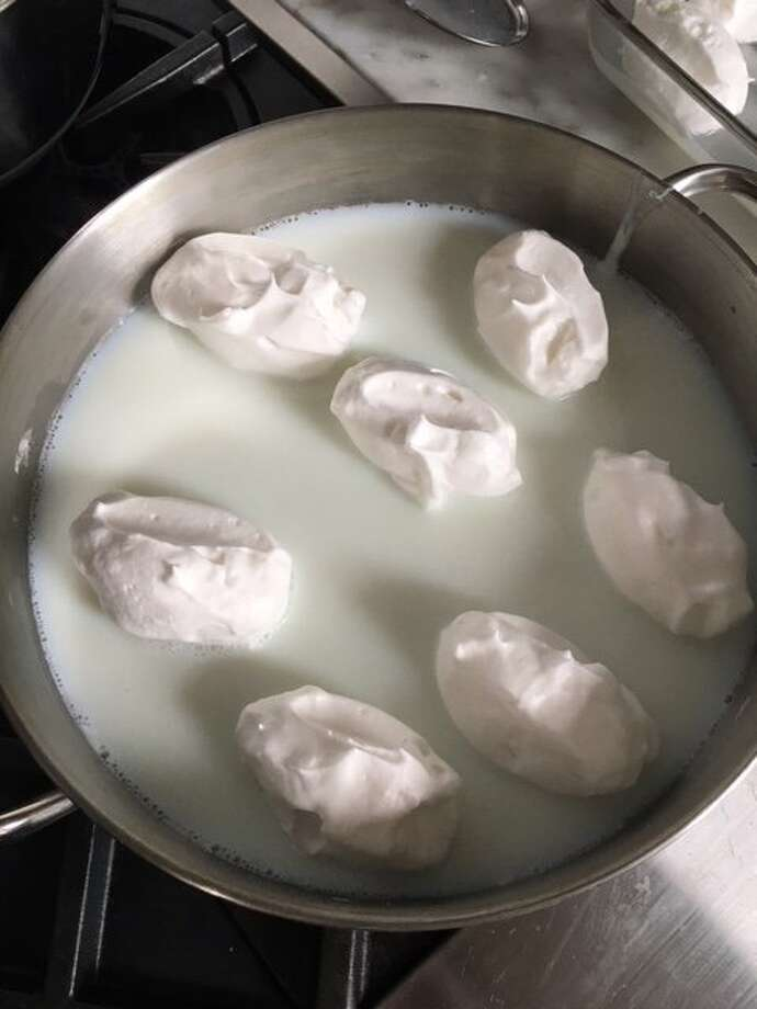 Meringues are poached in a milky bath for Oeufs a la Neige. Photo: Jessica Battilana, Special To The Chronicle