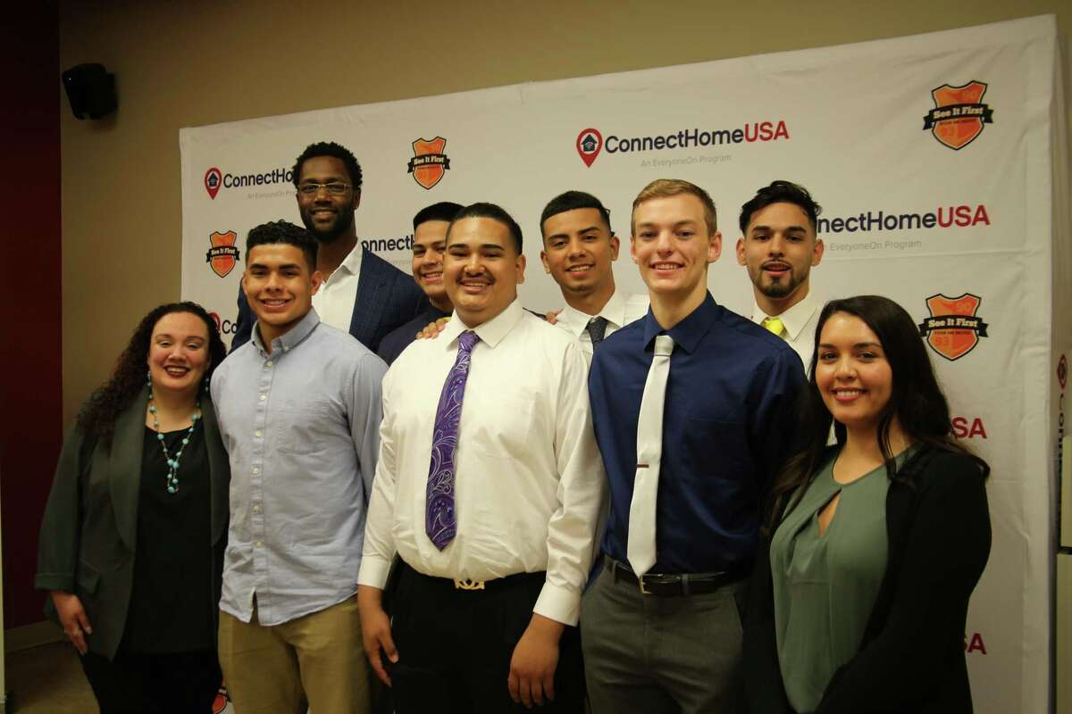 Michael Johnson, left top row, joins a group of high school students committed to furthering their education at the next level.