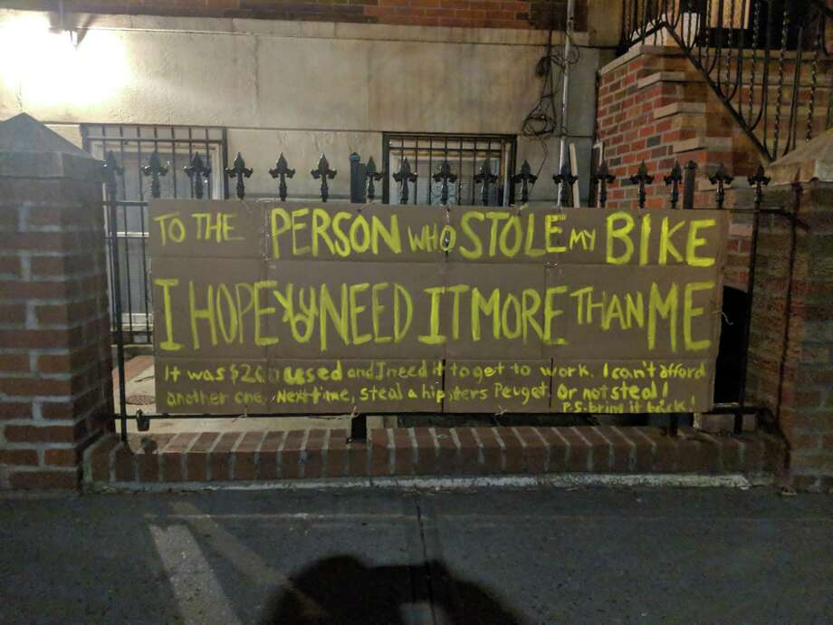 The sign Amanda Needham painted and hung on her New York brownstone after her bike was stolen. Photo: Courtesy Of Amanda Needham. / The Washington Post