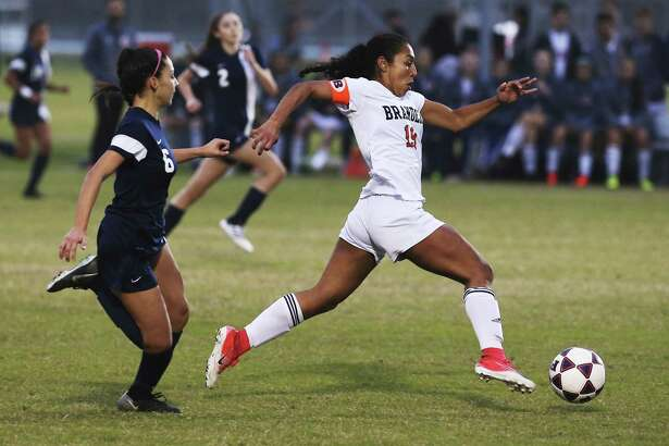 Brandeis' Marissa Arias (19) pushes the ball against O'Connor's Madison Herrera (06) during their game at Northside ISD Soccer Field on Friday, Feb. 9, 2018. O'Connor upset Brandeis 2-1. (Kin Man Hui/San Antonio Express-News)