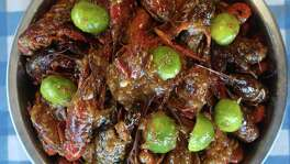 """Casian Crawfish's """"All-in"""" version adds Louisiana-style dry spices and lime to the Viet-Cajun garlic butter sauce."""