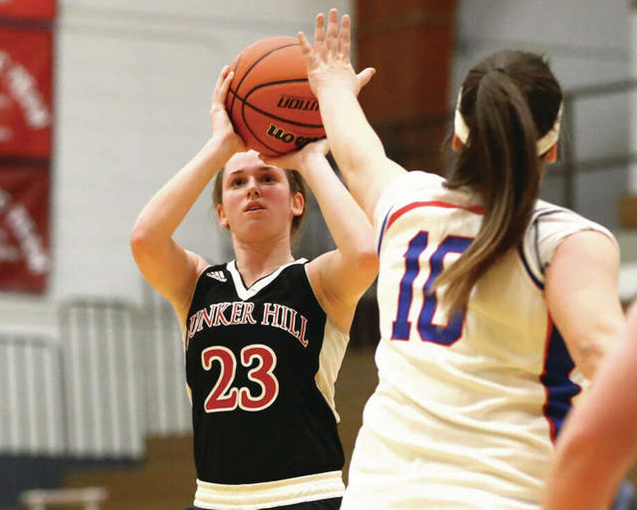 Bunker Hill's Mallory Schwegel (23) pulls up to shoot over Carlinville's Sydney Cania (10) during a game Dec. 18 game in Carlinville. Schwegel, who scored her 1,000th career point in the win, and Cania will both be back on the court at Carlinville on Sunday night in the 16th annual Carlinville Rotary Club All-Star Basketball Classic. Photo: Billy Hurst / For The Telegraph
