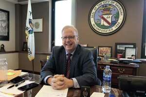 Danbury Mayor Mark Boughton returned to work at City Hall on Monday, after suffering a medical episode late last week at an event for Republican candidates for governor.