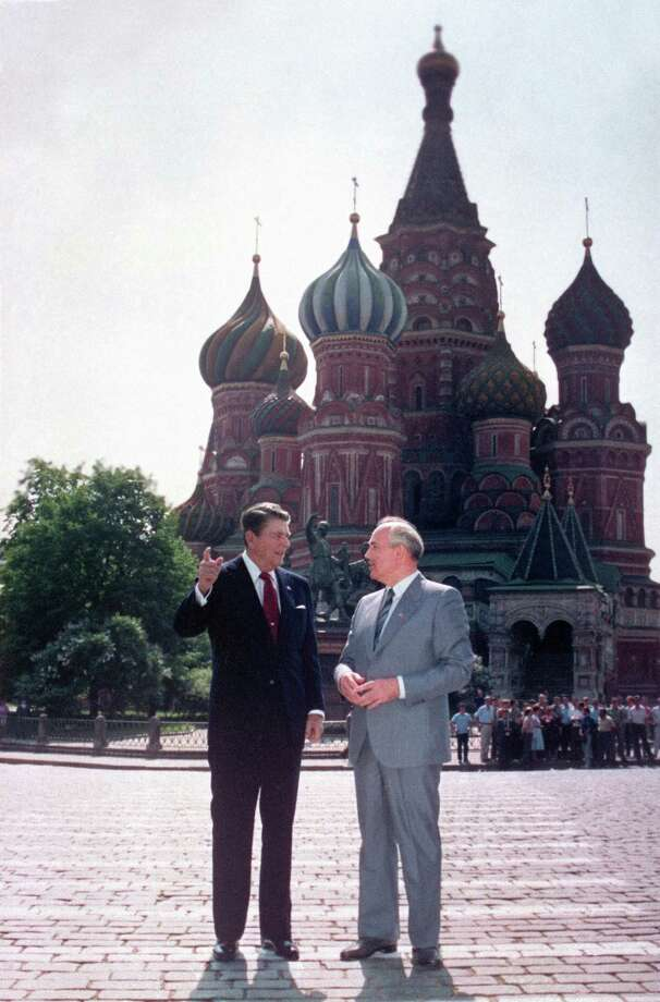 U.S. President Ronald Reagan, left, and Soviet leader Mikhail Gorbachev stand alone during an impromptu walk in Red Square in Moscow on May 31, 1988. In the background is St. Basil's Cathedral. Photo: Ira Sch /AP / AP