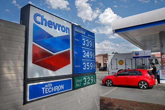 Vehicles refuel at a Chevron station in Point Richmond, Ca. on Tuesday September 12,  2017. A new study is laying blame for the warming of the planet on 90 companies, with Chevron and Exxon squarely at the top of the list.