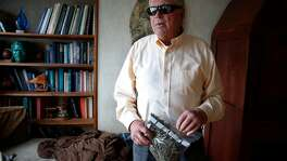 Ed Gallagher holds a baggie of medicinal cannabis at his Twin Peaks home in San Francisco, Calif. on Tuesday, March 13, 2018. After becoming totally blind a couple of decades ago and experiencing other ailments, Gallagher has relied on donated medicinal marijuana through a compassionate care act to control pain and nausea but a loophole in the recently enacted Prop. 64 has eliminated the distribution of free medical pot.