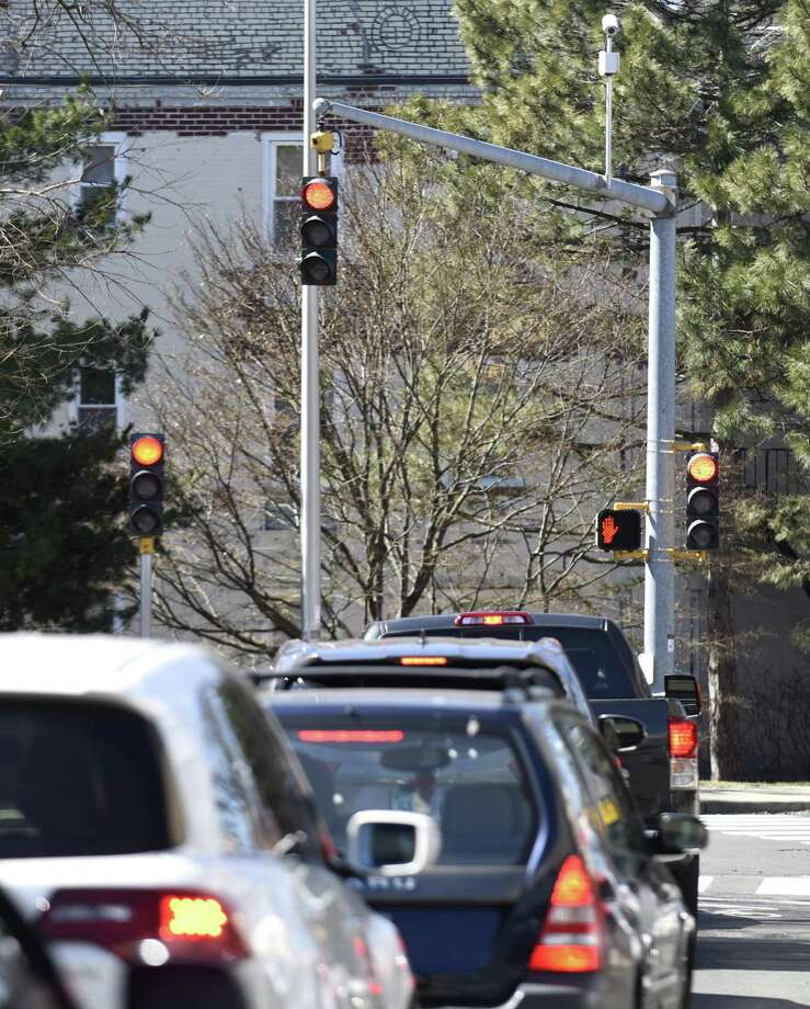 Three traffic lights signal traffic to stop at the end of the one way, one lane 6th Street in Stamford, Conn. Monday, March 18, 2018. City Representative John Zelinsky is calling for some of the unnecessary lights, including one facing a house with no street, to be taken down to save taxpayer money and eliminate confusion. Photo: Tyler Sizemore / Hearst Connecticut Media / Greenwich Time