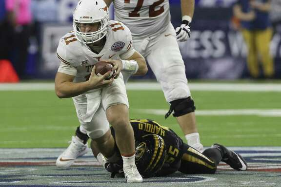 Texas Longhorns quarterback Sam Ehlinger (11) is brought down by Missouri Tigers defensive lineman Jordan Harold (55) while running the ball during the fourth quarter of the 2017 Academy Sports + Outdoors Texas Bowl game at NRG Stadium on Wednesday, Dec. 27, 2017, in Houston. The Texas Longhorns defeated the Missouri Tigers 33-16. ( Yi-Chin Lee / Houston Chronicle )