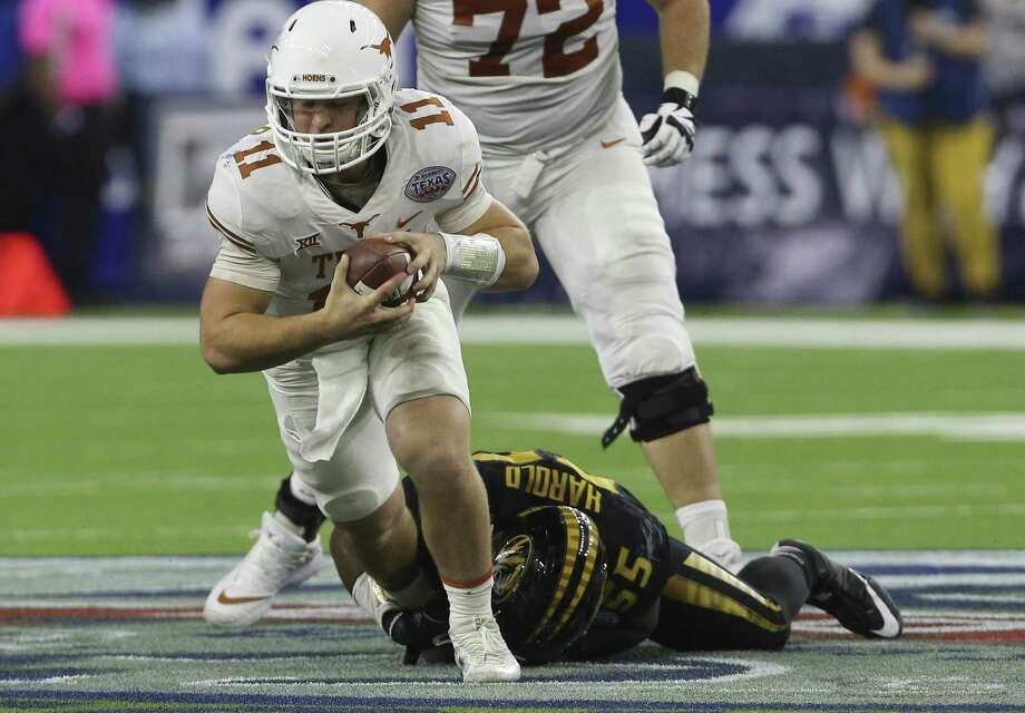 Texas Longhorns quarterback Sam Ehlinger (11) is brought down by Missouri Tigers defensive lineman Jordan Harold (55) while running the ball during the fourth quarter of the 2017 Academy Sports + Outdoors Texas Bowl game at NRG Stadium on Wednesday, Dec. 27, 2017, in Houston. The Texas Longhorns defeated the Missouri Tigers 33-16. ( Yi-Chin Lee / Houston Chronicle ) Photo: Yi-Chin Lee, Houston Chronicle / Houston Chronicle / © 2017  Houston Chronicle