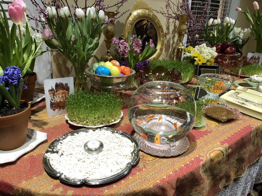 "A haft seen table is seen at the Berkeley Persian Center. The table traditionally is decorated with symbolic items, seven of which start with the letter ""s"" in Farsi. Photo: Alix Martichoux"