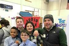 Steve McAuley, a fifth grade teacher at Wolfpit Elementary School, with students who competed in the regional Invention Convention on Sunday, March 18.