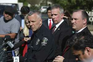 From left, Austin Police Interim Chief Brian Manley, ATF Agent in Charge Fred Milanowski and FBI Agent in Charge Christopher Combs hold a press conference near the scene of an explosion on the southwest side of Austin.