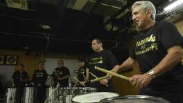 Ben Macias of the group Kazamba, a drum and dance ensemble, plays with others at VFW Post 76 on Wednesday, March 7, 2018.