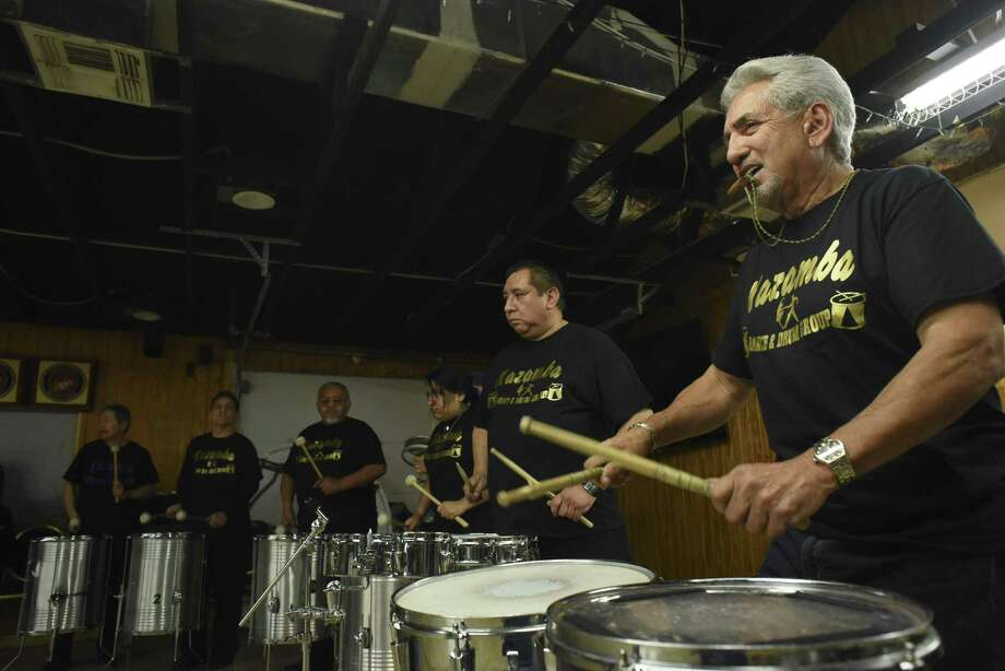 Lead drummer Ben Macias (right) rehearses with other members of the Kazamba Dance & Drum Group earlier this month. Photo: Photos By Billy Calzada /San Antonio Express-News / San Antonio Express-News