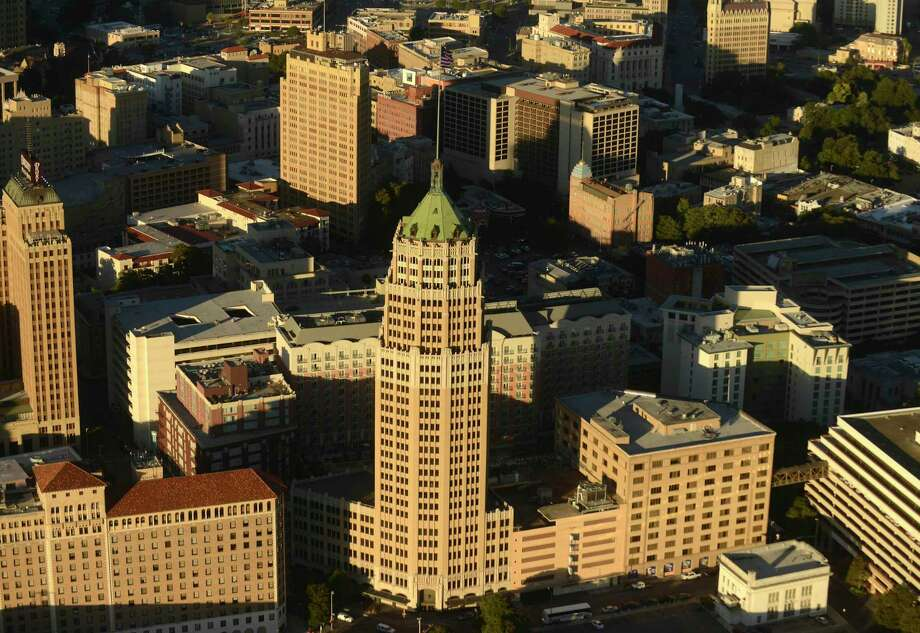 The Tower Life Building, which has graced the San Antonio skyline since 1927, is one of about 200 buildings in the newly designated federal Historic District that encompasses the downtown and the River Walk. Photo: Billy Calzada /San Antonio Express-News