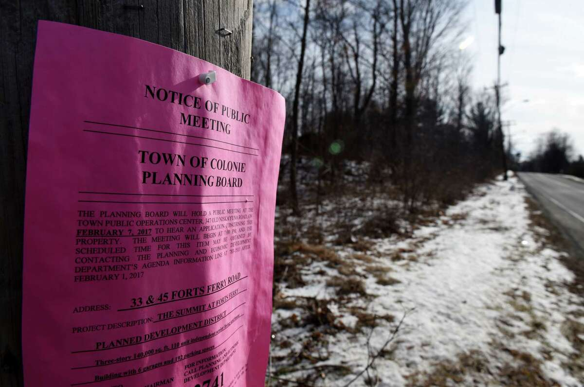A Colonie Planing Board notice is posted at 33 and 45 Forts Ferry Rd. on Monday, Jan. 30, 2017, in Colonie, N.Y. Developer Frank Nigro is proposing to build a three-story apartment building and a two-story office structure. (Will Waldron/Times Union archive)