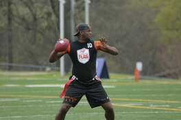 Former UT football player Vince Young competes with his team at  the  American Flag Football League's  (AFFL) inaugural US Open of Football (USOF) tournament.