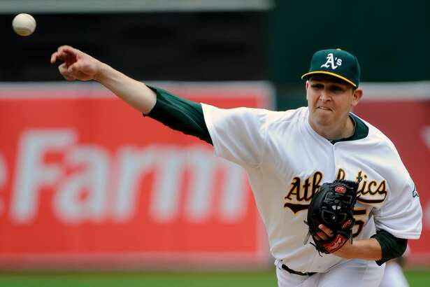 OAKLAND, CA - JULY 16: Trevor Cahill #53 of the Oakland Athletics pitches against the Los Angeles Angels of Anaheim in the first inning during an MLB baseball game at the O. co Coliseum July 16, 2011 in Oakland, California.