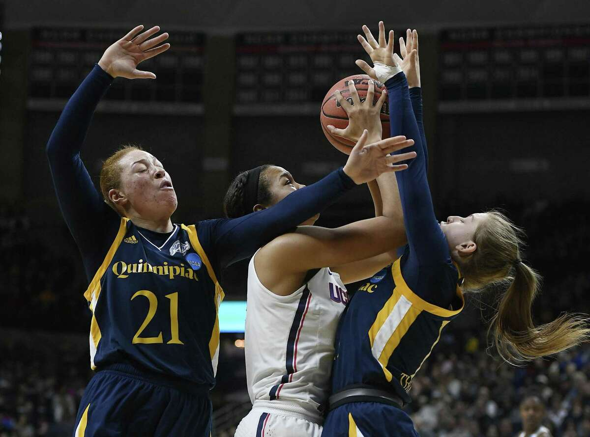 UConn's Napheesa Collier, center, shoots as Quinnipiac's Jen Fay, left, and Edel Thornton defend on Monday in Storrs.