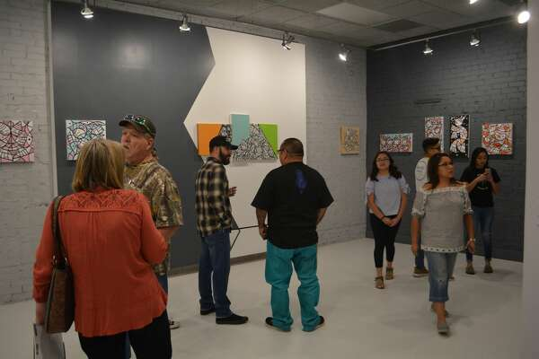 Patrons check out the new exhibit at the Contemporary Art Museum Plainview titled The Big Flip: The Art of Skateboarding, which will run from now until June 10.