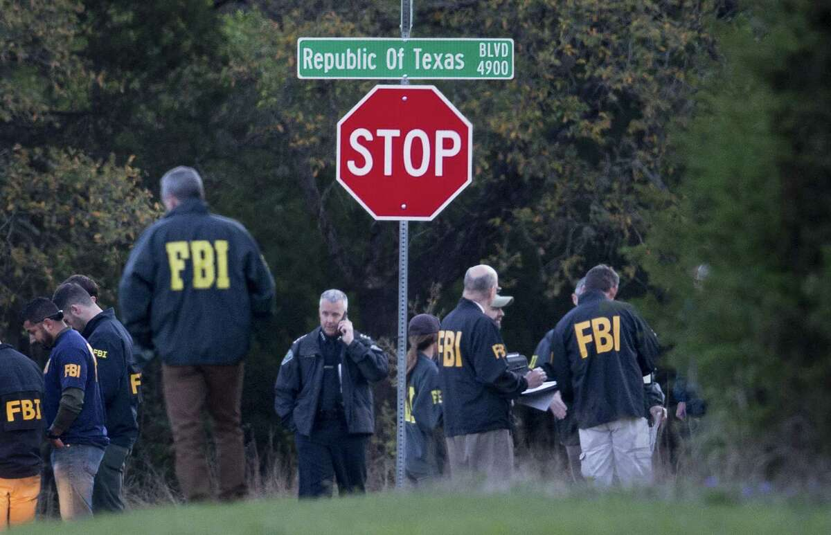 Law enforcement officers gather at the intersection of Republic of Texas and Mission Oaks to investigate Sunday evening's bombing.