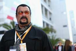 SOCHI, RUSSIA - OCTOBER 11:  Actor Steven Seagal  attends qualifying ahead of the Russian Formula One Grand Prix at Sochi Autodrom on October 11, 2014 in Sochi, Russia.  (Photo by Clive Mason/Getty Images) ORG XMIT: 511522755