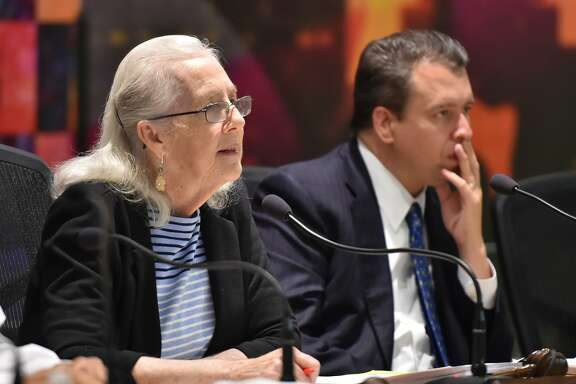 SAISD Board President Patti Radle and Superintendent Pedro Martinez listen during a board meeting this year. Expected declines in enrollment will force elimination of teacher and staff positions next year. District officials were advising 60 teachers this week to resign or have their contracts terminated when the board meets Monday.