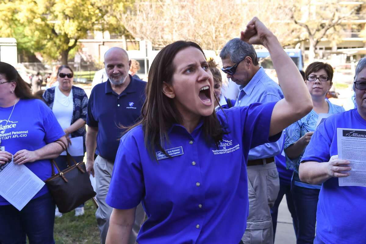 Katy Bravenec, a Union Organizer for the Alliance of San Antonio Teachers and Support Personnel leads chants during a rally prior to a SAISD Board meeting in March, when the board appoved a contract with Democracy Prep, a charter network, to operate Stewart Elementary School.