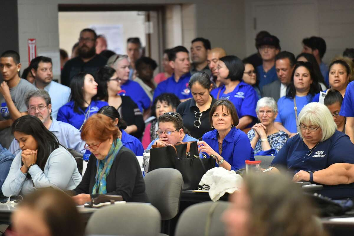 A large crowd that included members of the Alliance of San Antonio Teachers and Support Personnel listen during a SAISD board meeting last March, when the board appoved a contract with Democracy Prep, a charter network, to operate Stewart Elementary School.