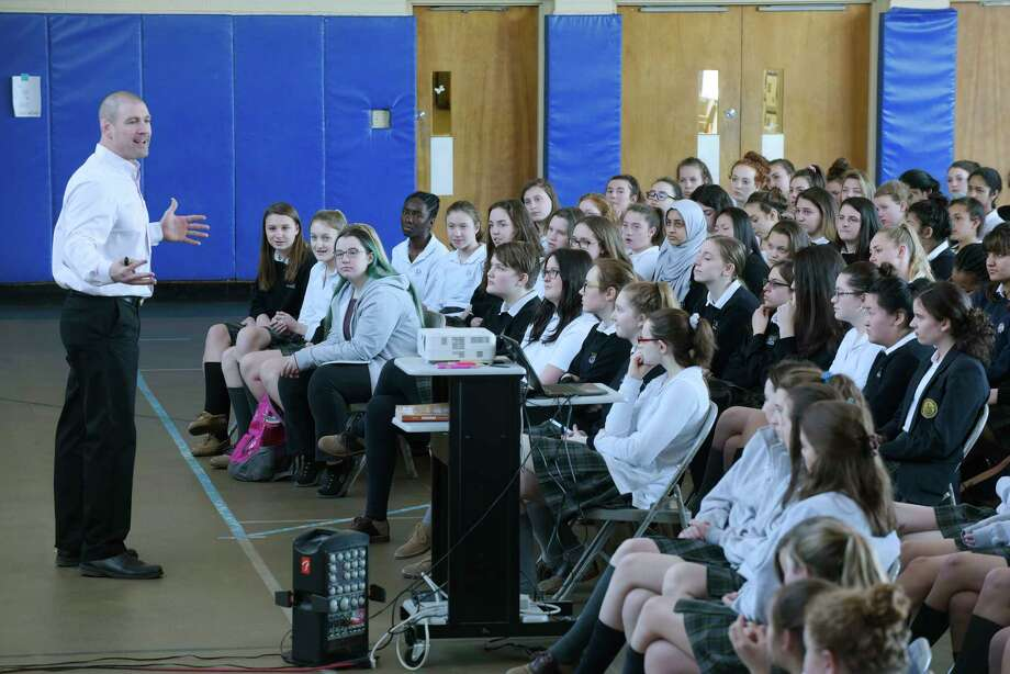Tom Murphy talks to students during a anti-bullying program Sweethearts & Heroes at the Academy of the Holy Names on Monday, March 19, 2018, in Albany, N.Y. The Sweethearts & Heroes organization was started 10 years ago by Tom Murphy of St. Albans Vermont and Jason Spector, a teacher in South Glens Falls. The goal of the program is to show students the impact that bullying has and to show them that they have the potential to be someone's hero. The program works to empower bystanders to make a difference. The program at the academy was sponsored by Northwestern Mutual.  (Paul Buckowski/Times Union) Photo: PAUL BUCKOWSKI / (Paul Buckowski/Times Union)