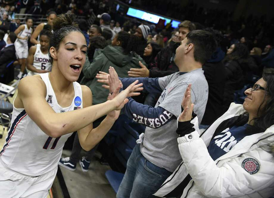 UConn's Kia Nurse high-fives fans at the end of a second-round game in the NCAA tournament on Monday in Storrs. Photo: Jessica Hill / Associated Press / AP2018