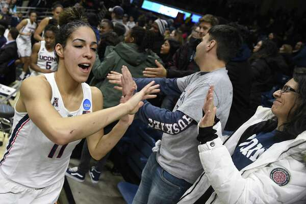 UConn's Kia Nurse high-fives fans at the end of a second-round game in the NCAA tournament on Monday in Storrs.