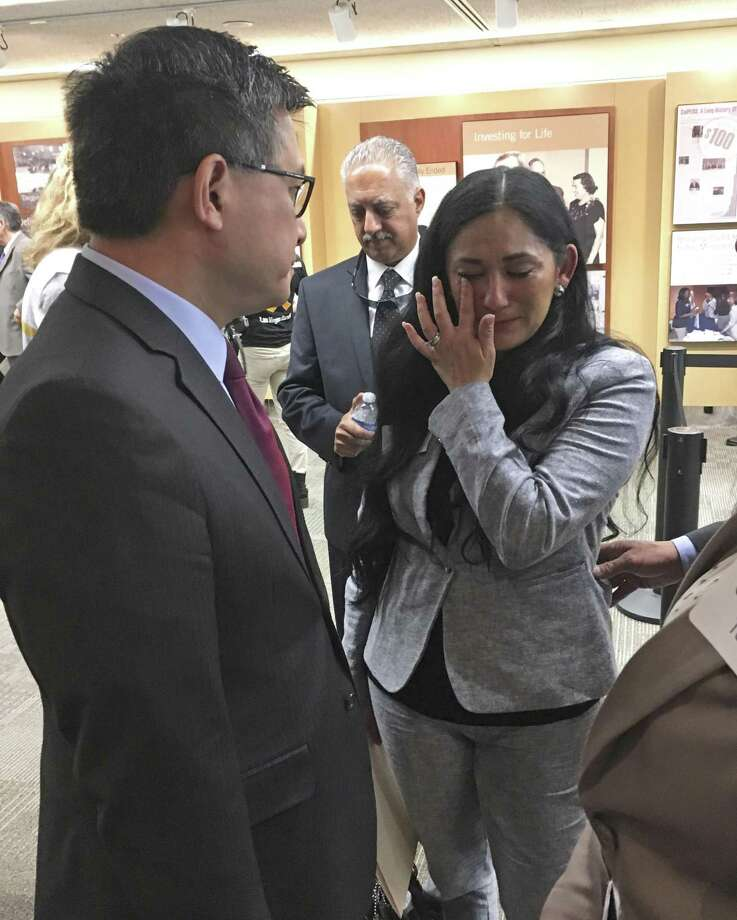 California Treasurer John Chiang Monday speaks to Erica Porteus, right, whose sister was killed in the 2015 terrorist attack in San Bernardino, Calif. Photo: Kathleen Ronayne / Kathleen Ronayne / Associated Press / Copyright 2018 The Associated Press. All rights reserved.