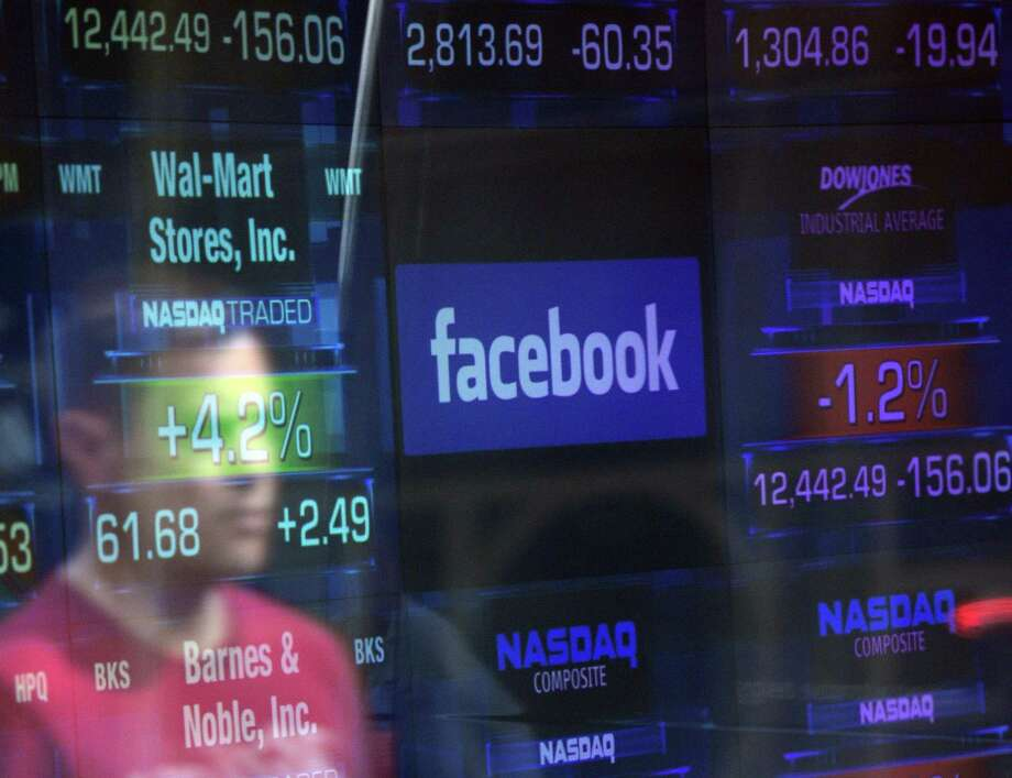 A Facebook logo is seen through the windows of the NASDAQ stock exchange. Facebook shares tumbled Monday. Photo: EMMANUEL DUNAND / Emmanuel Dunand / AFP/Getty Images File / AFP or licensors
