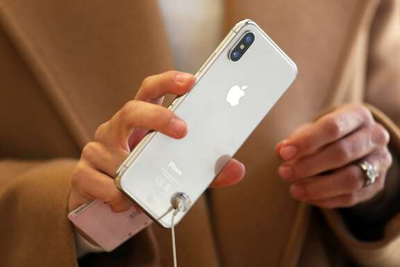 A customer tests an iPhone X smartphone.
